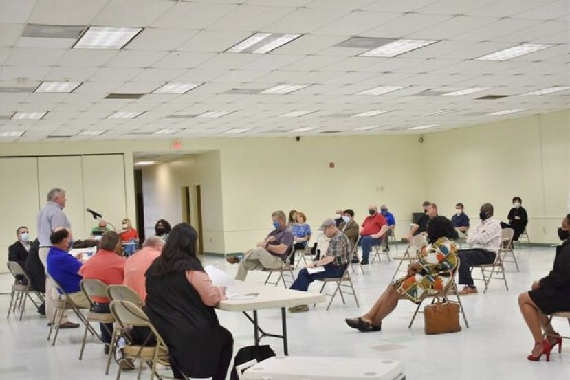 Citizens, pilots, and region leaders discuss the proposed Moody airspace initiative Monday in Douglas.