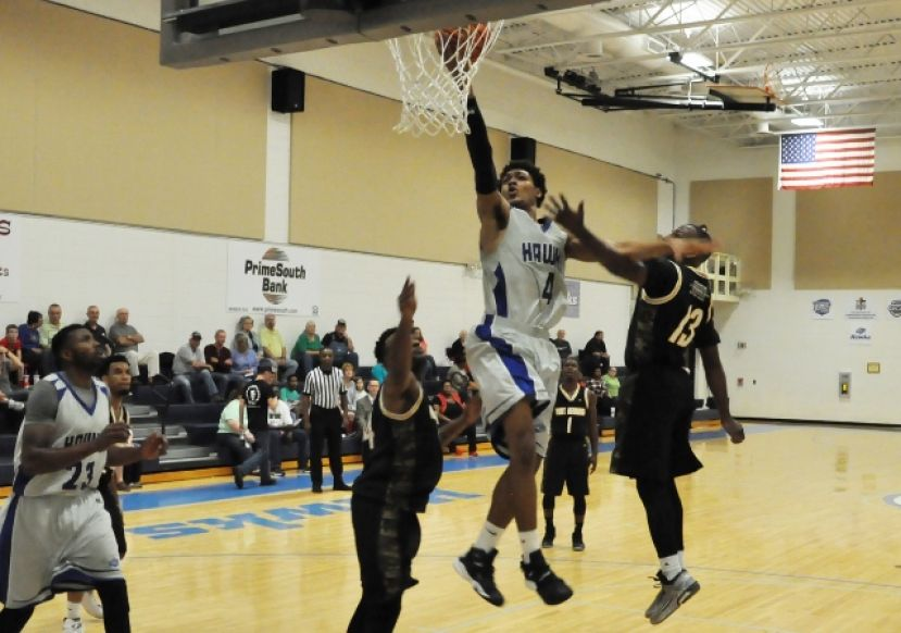 Andre Elam makes a layup Thursday night against the Fort Benning All-Army Team.