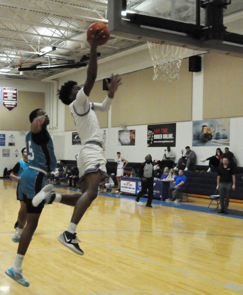 Jalen King flies high for two of his 16 points Saturday afternoon against Combine Academy.