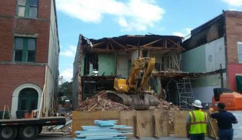 City demolishes condemned downtown building, previous owner had gifted it to Douglas