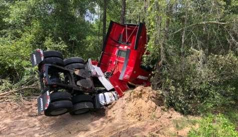 Video: Truck overturns near Ambrose, blocks highway for several hours