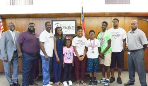 City recognizes track team, votes to increase funding for sewer project