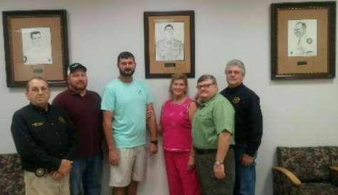 Sheriff adds portrait to wall of fallen officers