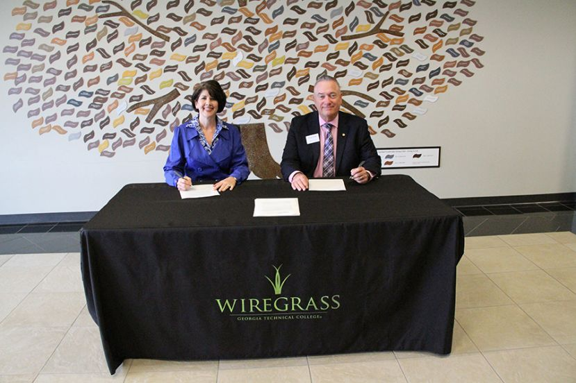 Wiregrass President Dr. Tina K. Anderson and Herzing University Associate Vice President of Community Partnerships, Thomas P. Perin, Sr. signed an articulation agreement that could open up opportunities for Wiregrass graduates to pursue a bachelor's degree online.