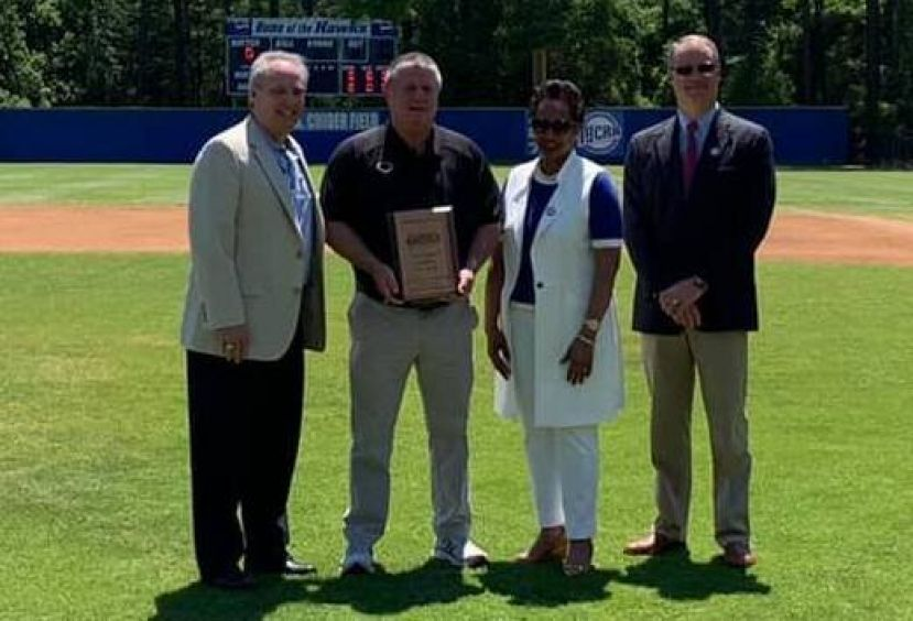 From left: GCAA commissioner David Elder, Scott Sims, SGSC president Dr. Ingrid Thompson-Sellers, and SGSC Vice President of Advancement, Government Relations, and Athletics Dr. Greg Tanner.